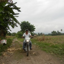 My brother tailing our ride as I was leaving the farm. Aww.. :(