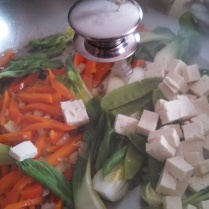 Add the tofu and vegetables. Stir then cover. Let cook for 30 seconds.