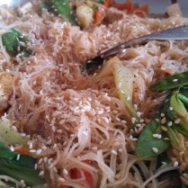 Add the flax seeds and Sesame seeds. Stir-fry until well combined and rice noodles are tender and the liquid is completely absorbed.