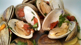 The clams are cooked when they opened up.