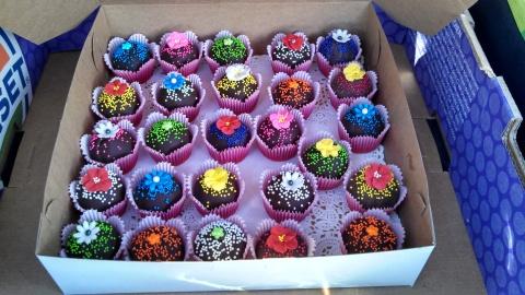 Simple but original design using sprinkles and homemade fondant and sugar flowers.