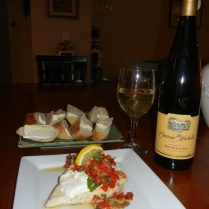 Copycat Carraba's Chicken Bryan topped with goat cheese, sundried tomatoes, basil and lemon butter sauce. Served with white wine and Artisan bread with Brie cheese.